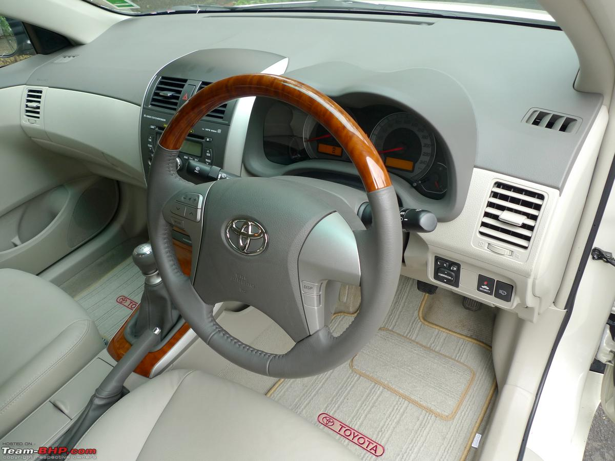 Toyota Corolla Altis 14 D 4d Diesel Test Drive Review Team Bhp 2010 Fuse Box 4 Spoke Steering Wheel With Faux Wood Accents Mid Audio Controls Integrated Size Too Thindoesnt Feel Chunky To Hold