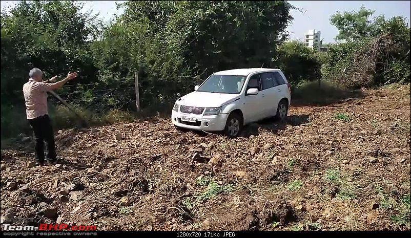 A Mercedes GL, 2 Grand Vitaras, a Sugarcane farm and a tow cable-033-mt-gingerly-crossing-furrow.jpg