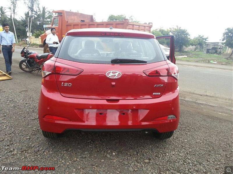 What happened to good looking cars?!-red2015hyundaii20rearviewspyshot.jpg