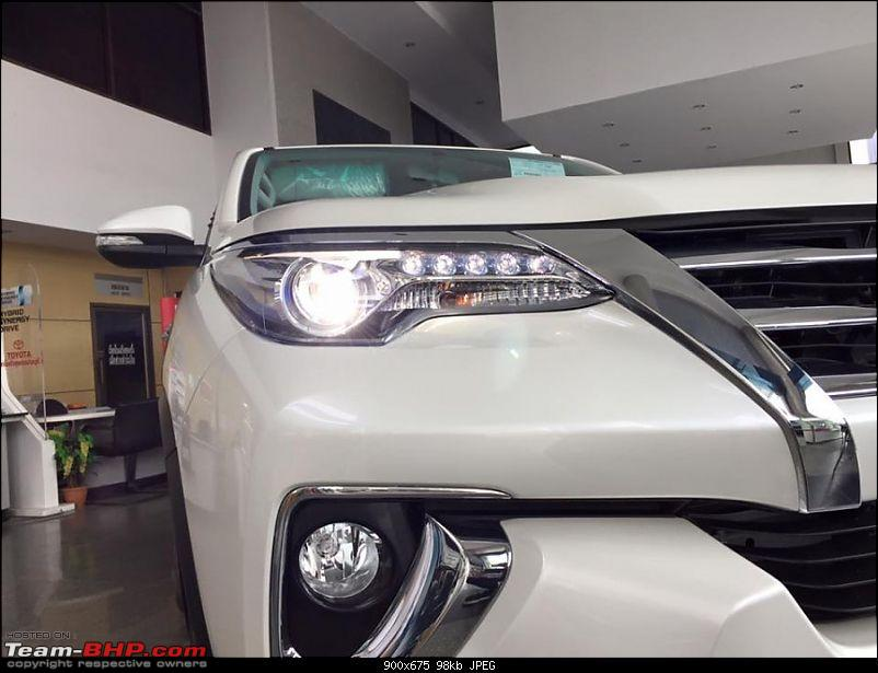 New Toyota Fortuner caught on test in Thailand-2016toyotafortunerheadlampsontheshowroomfloorpostunveil900x675.jpg