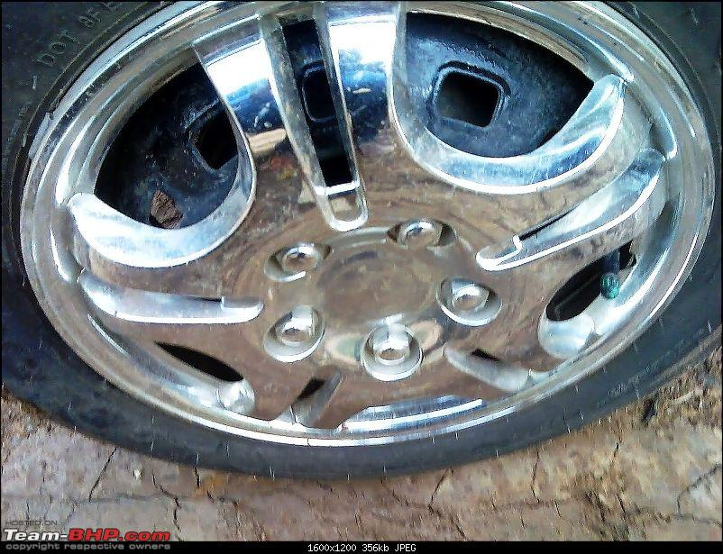 Spark LS LPG - 19000kms User Review-wheel-cap.jpg