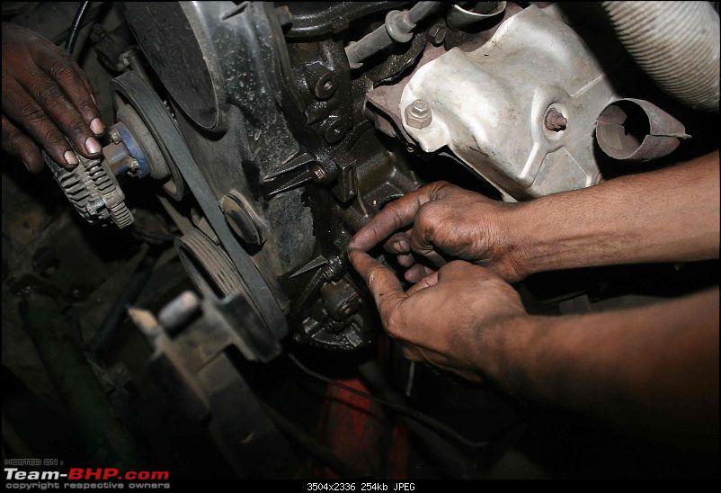 Power steering for Gypsy.-mechanic-showing-mounting-steering-pump.jpg