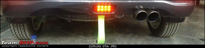 What are those colorful straps hanging off the rear tow hook of cars?-35a82a198ad7492fa67300fedec1ab53.jpeg