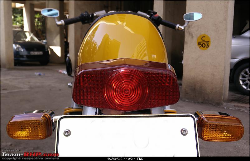 Me, myself and the Enfield Continental GT-back_close.png <u>Blast from the past. Period inspired tail light.</u><br /> <br /> <br /> <b>First Service</b><br /> <br /> I was really looking forward to the first service. Keeping the bike below 60 KMPH and taking ten minutes break every hour requires will power of a monk! <br /> <br /> The experience was decent enough. Was asked if I wanted oil additive added and chain cleaned and lubed (instead of simple greasing), said yes to both. <br /> <br /> Here's the cost breakup:<br /> Chain Lubing: Rs 168.54 /-<br /> Oil Filter: Rs 93 /-<br /> Engine Oil (2.50 liter): Rs 772.51 /-<br /> Oil Additive: Rs 270 /- (really curious to know what this is, I was told its a coolant)<br /> Consumable: Rs 50 /- (read as: we don't know what was used but are going to charge you 50 bucks anyway. This is a money making trick every workshop religiously follow)<br /> <br /> Whew! can finally take the bike to 90 KMPH, feels liberating.<br /> <br /> <a href=