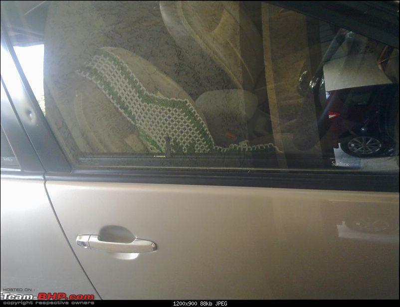 Mahindra XUV500 : Test Drive & Review-sunteck-retractable-door-sunshade-1.jpg