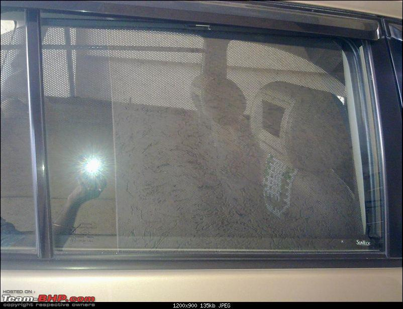 Mahindra XUV500 : Test Drive & Review-sunteck-retractable-door-sunshade-2.jpg