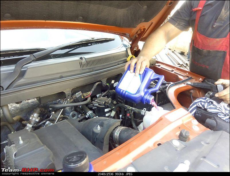 Mahindra TUV300 : Official Review-technician-pouring-coolant-reservoir.jpg
