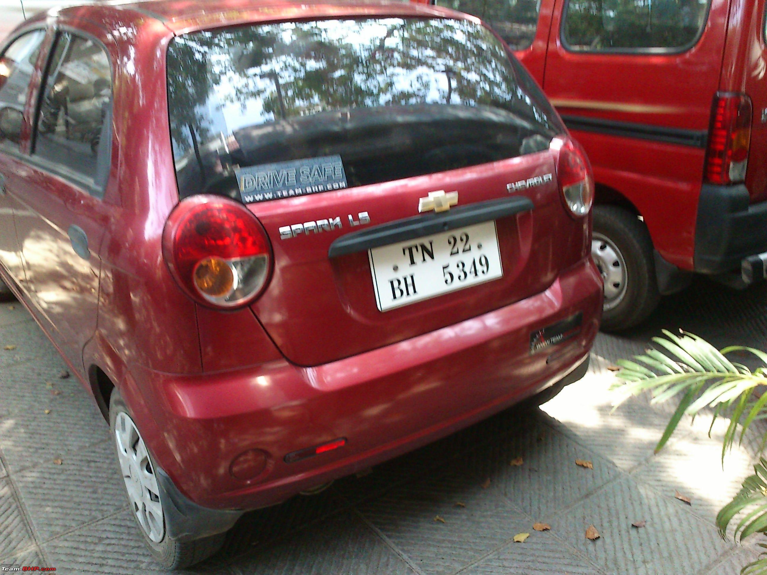 Car red chevrolet spark tn 22 bh 5349 with drive safe and t bhp sticker on the hatch and bumper