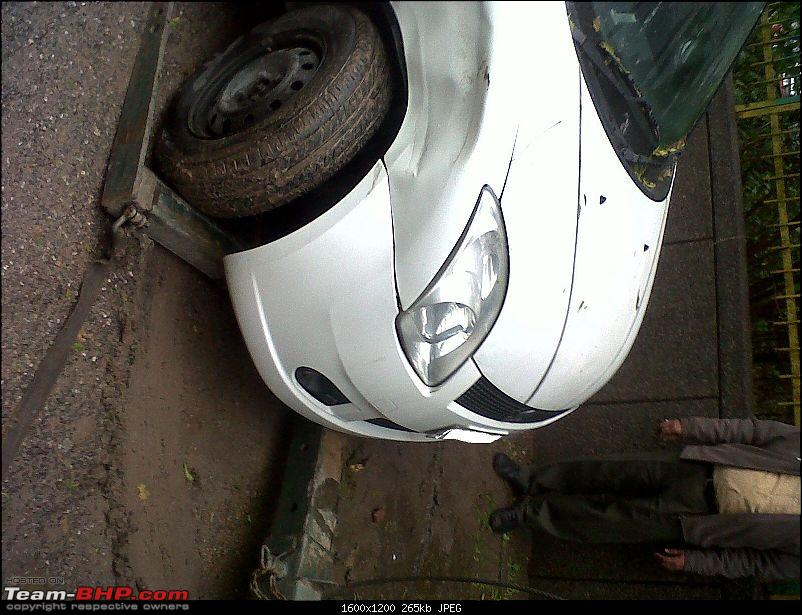 My parked Swift VDi smashed by an Innova-img00126201302051312.jpg