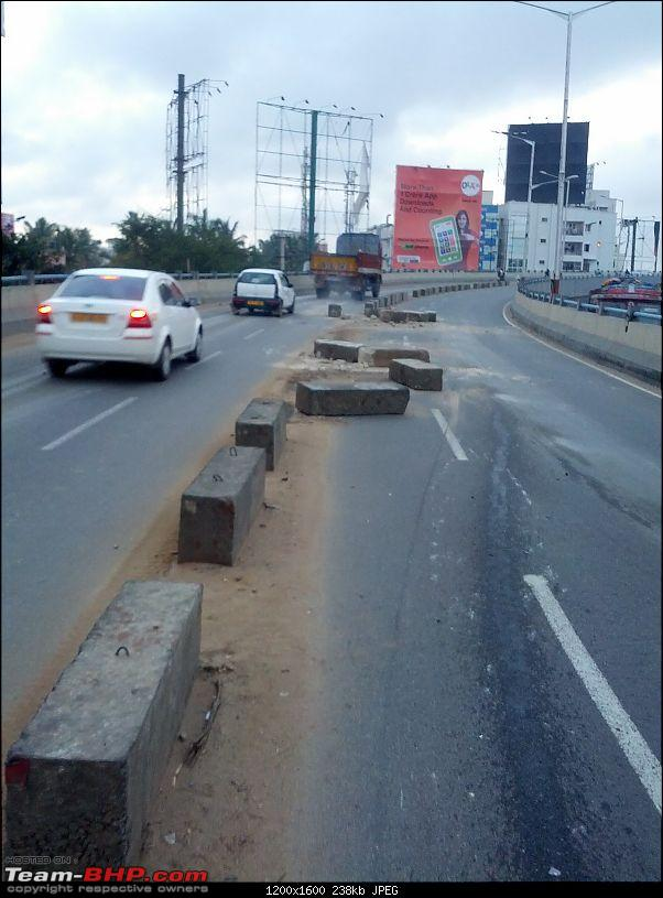 When road dividers crash into you for a change!-img_20140726_061025.jpg