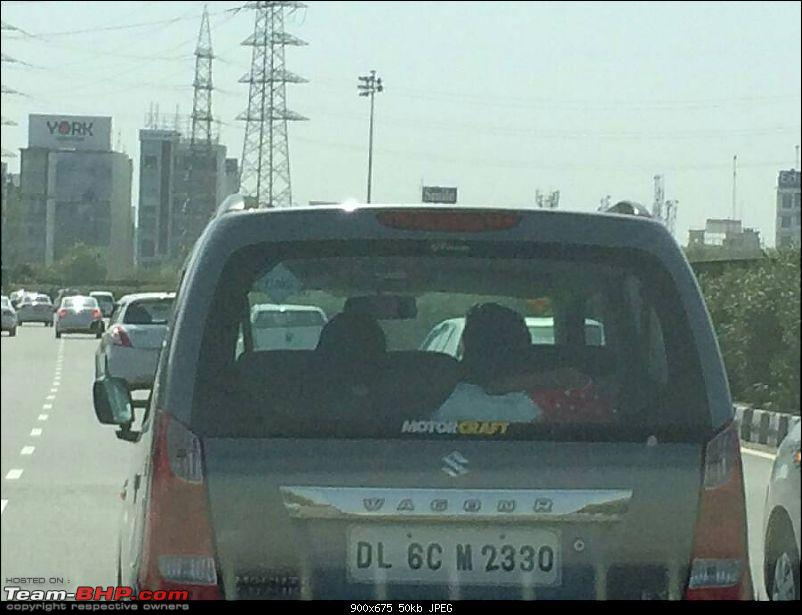 Idiot driving with a child on the parcel tray!-1444031774285.jpg