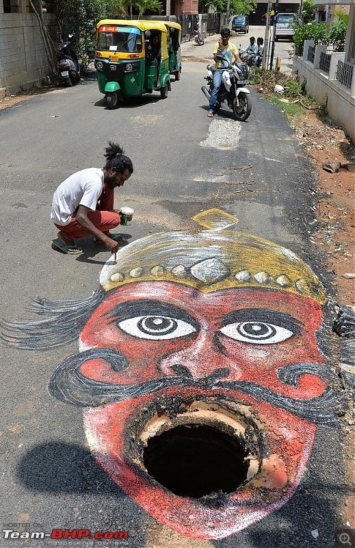 Pothole problems - Bengaluru artists use creative methods to embarrass civic authorities-yamraaj.jpg