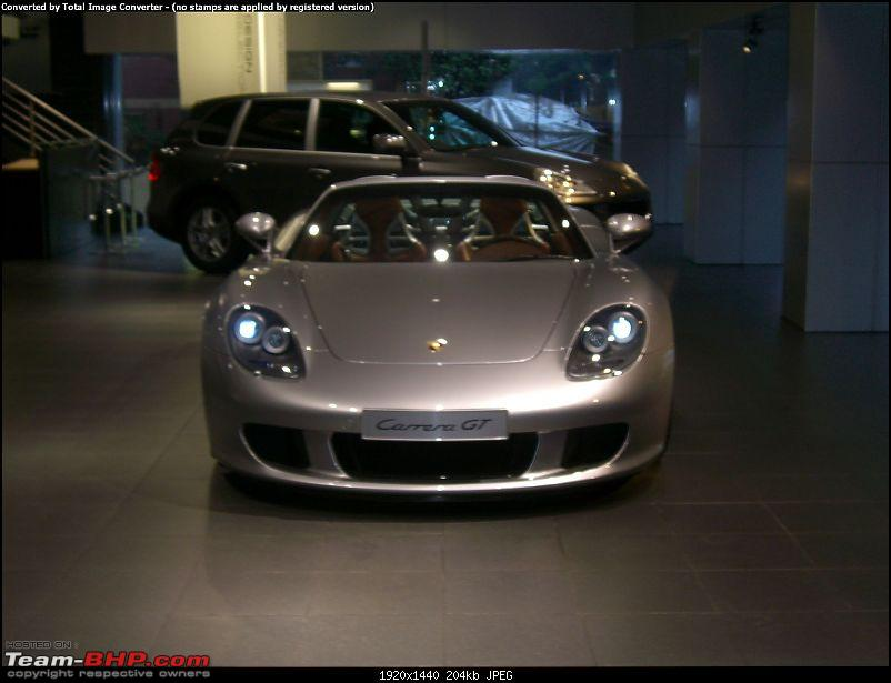 Red Porsche Carrera GT in Mumbai. EDIT: Silver one visiting as well...-cimg1186.jpg