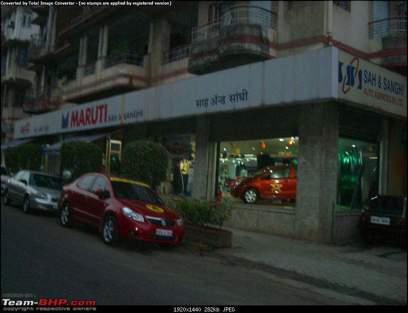 Red Porsche Carrera GT in Mumbai. EDIT: Silver one visiting as well...-cimg1211.jpg