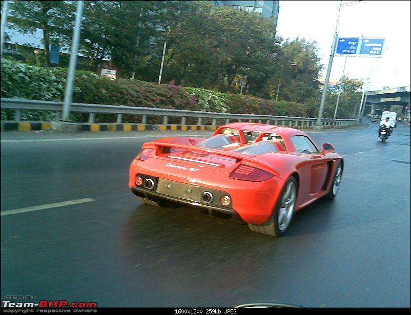 Red Porsche Carrera GT in Mumbai. EDIT: Silver one visiting as well...-1carreragt.jpg