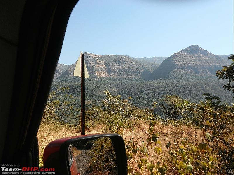 Poll: Maruti Vitara Brezza vs Ford EcoSport vs Mahindra TUV300-34one-few-sign-posts-mountains-valley-backdrop.jpg