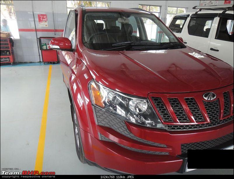 Sita, Red Mahindra XUV5OO W8 joins our Family. EDIT: 1 Year & 35,000 kms up-pose4.jpg