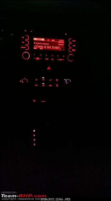 It's orange and it's sexy – My 2014 Kia Sportage-centre-console-night.jpg