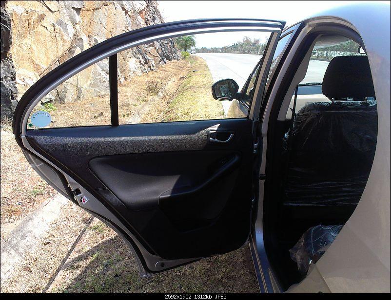My Tata Zest XT 1.3L Quadrajet - Platinum Silver-19rear-door.jpg