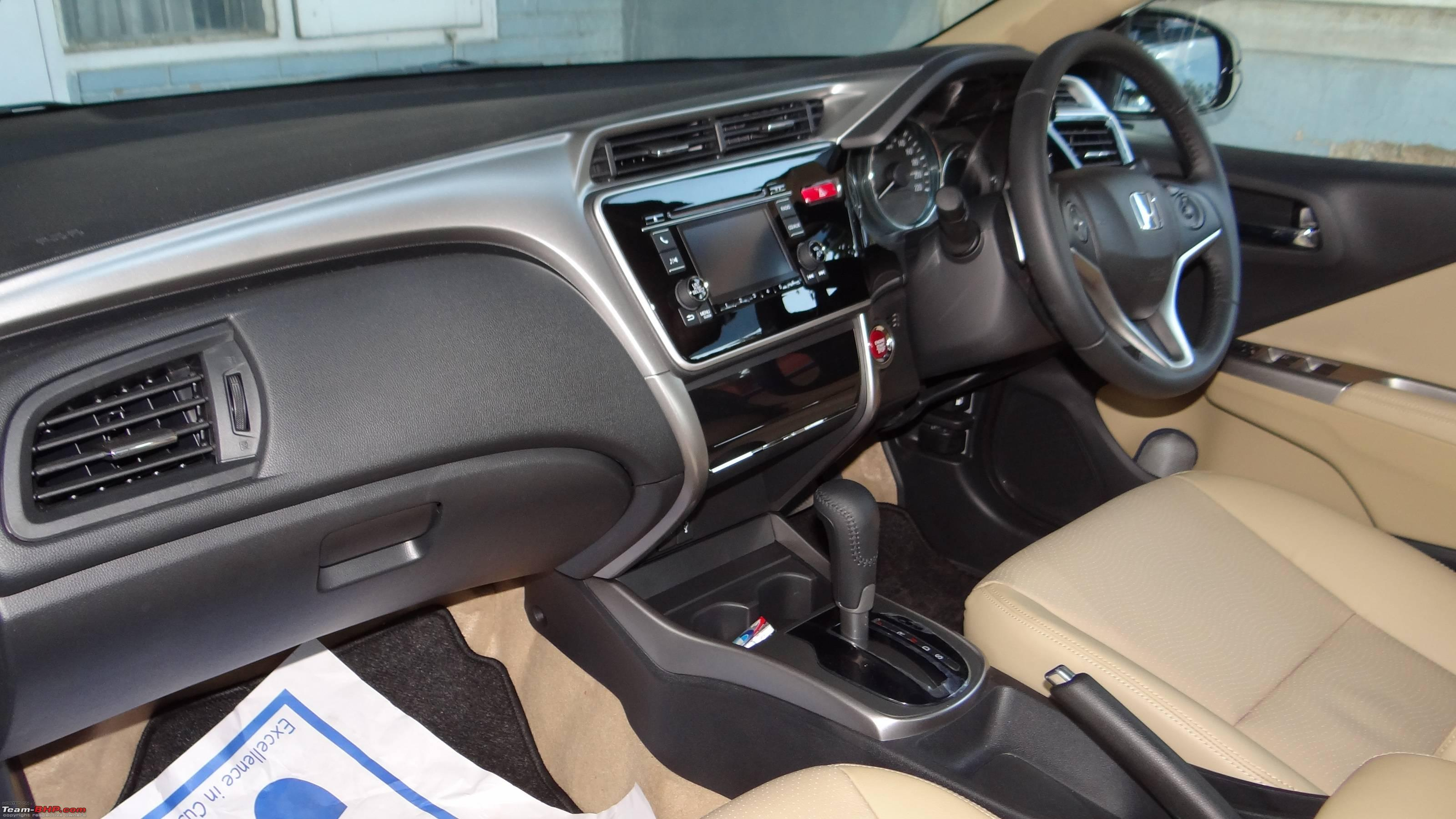 https://www.team-bhp.com/forum/attachments/test-drives-initial-ownership-reports/1353243d1427223830-my-first-automatic-car-honda-city-cvt-vx-paddle-shifters-dsc02689.jpg