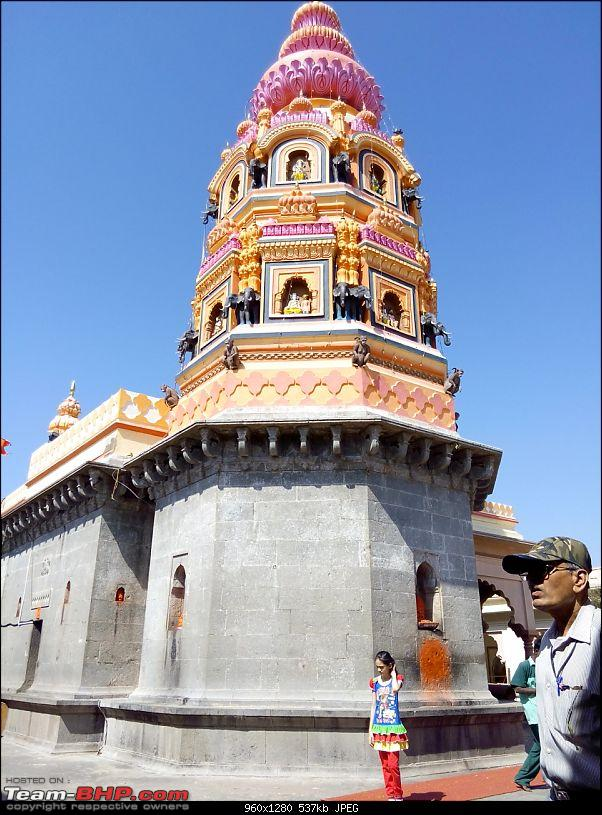 Toyota Innova: My Pre-worshipped Black Workhorse-rear-side-morgaon-temple-look-colourful-dome.jpg