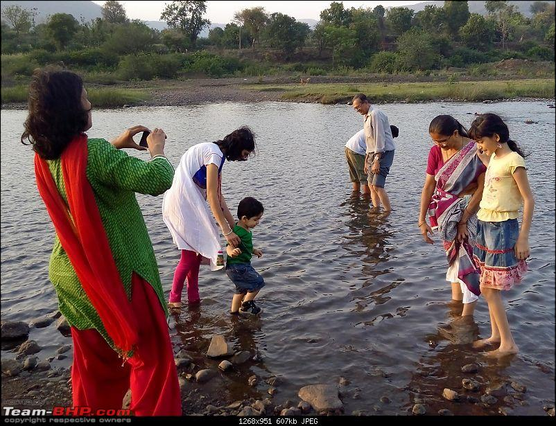 Toyota Innova: My Pre-worshipped Black Workhorse-family-enjoying-shallow-bhima-waters.jpg <br /> Reflections of the day gone by<br /> <a href=