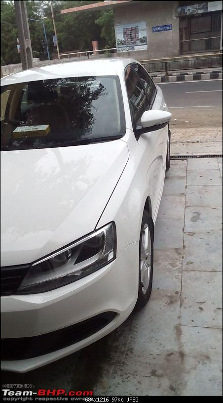Sasha: My candy white VW Jetta Trendline-side.jpg