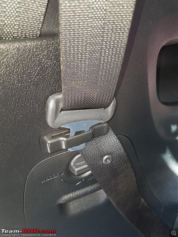 Toyota Innova Crysta 2.4 GX ownership review-seat-belt-holder.jpg