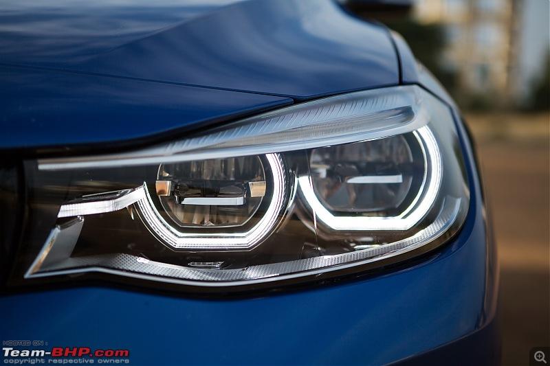 A GT joins a GT - Estoril Blue BMW 330i GT M-Sport comes home-headlight.jpg