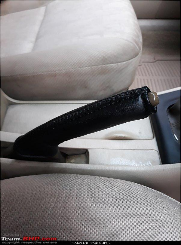 Why did I buy a 12 Year old Toyota Corolla - My experience-new-hand-brake-cover.jpg