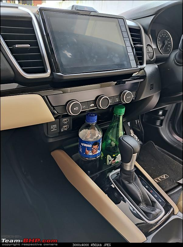 Athena | My 5th-Gen Honda City Review-1.28-cubby-hole-size-fits-plus-screen-smear.jpg