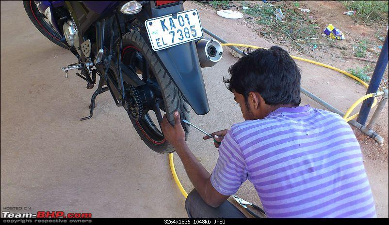 Bangalore to Chikmagalur - 3 Yamahas race to the Young Girl's Town-fixing-flat-tire.jpg