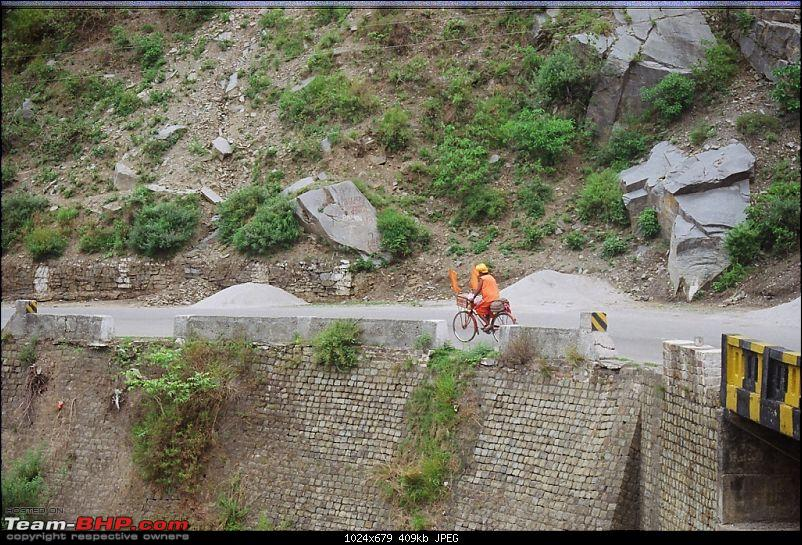 One more tribute to Leh this season...-saadhu-riding-cycle.jpg <br /> We had already spoken to Mr. Sunil of Himachal Taxi Union and had arranged for a Qualis for Leh drop from Manali. He also helped us with arranging for a hotel room for 2-3 hours where we could get freshened-up before the next leg of journey. We reached Manali next day morning by 10:00AM and directly went to the hotel. We were all ready in next one hour for Manali – Leh leg of the journey. Sonu was ready with his Qualis to take us to Leh.<br /> <br /> <a href=