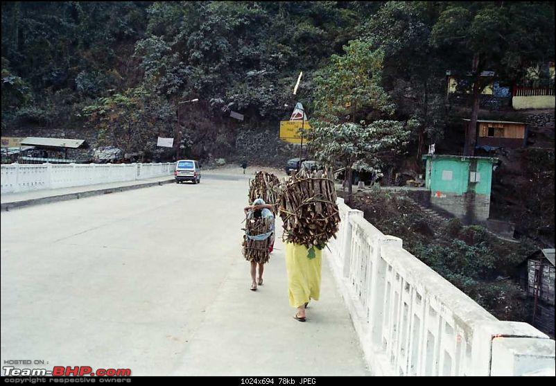 An incredible journey of a lifetime to Bhutan, Kalimpong, Darjeeling and Gangtok!-women-carrying-firewood-teesta-bridge.jpg