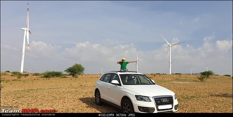 Putting an Audi Q5 to the test on a farm and in mountains-audi-near-windmills_li.jpg