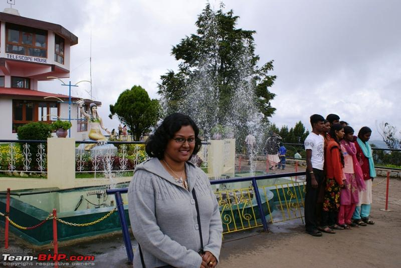 Name:  w Wifey near the fountain_Telescope house in the background_see the crowd inside.JPG